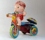 Jucarie veche din tabla baiat pe tricicleta - de colectie Japonia