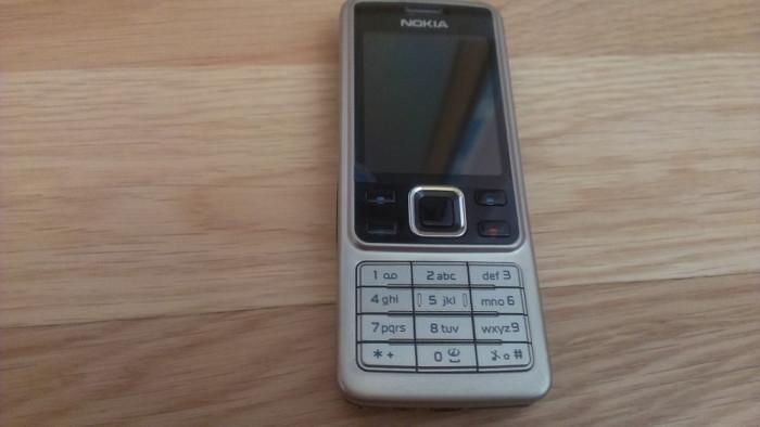 Telefon mobil Nokia 6300 Argintiu-Silver incarcator carcasa+baterie noua P59