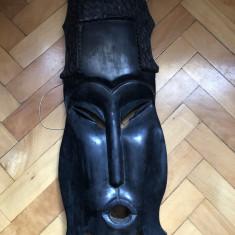 Masca africana, in basorelief, sculptata, in lemn, esenta tare, dimensiuni mari - Arta din Africa