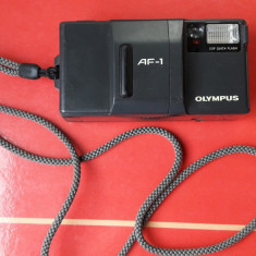 Olympus Af-1 MADE IN JAPAN ,FUNCTIONEAZA , ARE SI BATERIE .
