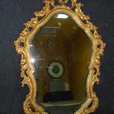 Eleganta oglinda antica cu rama din lemn masiv sculptata manual