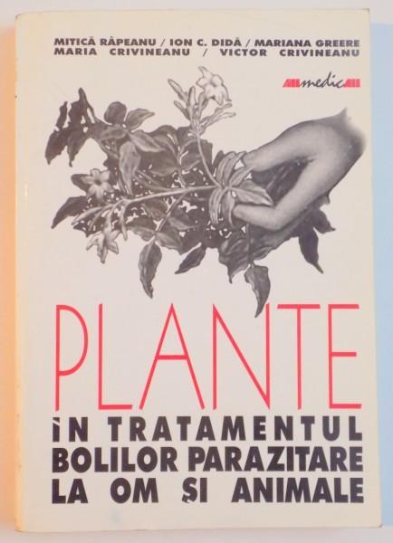 PLANTE IN TRATAMENTUL BOLILOR PARAZITARE LA OM SI ANIMALE de MITICA RAPEANU , ION C. DIDA , MARIANA GREERE ... 2001 foto mare