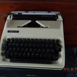 Masina de scris transport inclus in pret