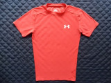 Tricou Under Armour HeatGear.  Marime M;  82% poliester cationic, 18% elastan.