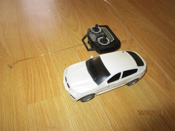 Masinuta BMW cu telecomanda Scara 1:26 (18cm)