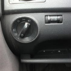 Bloc lumini cu proiectoare si reglaj faruri+iluminare bord VW Polo 1,4TDI an 2007