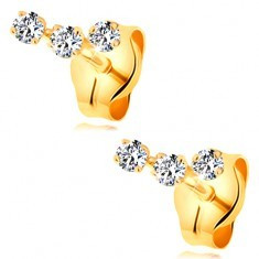 Cercei din aur galben 14K - arc format din trei zirconii mici, transparente