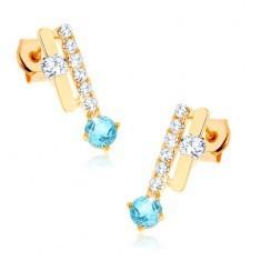 Cercei din aur 375 - două dungi, topaz albastru strălucitor, zirconii transparente