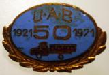 I.799 INSIGNA ROMANIA BRASOV 50 ANI UAB UZINA AUTOCAMIOANE AUTO 1921 1971