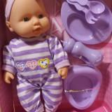 Bebelus vorbitor cu accesorii