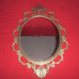 Oglinda de perete cu rama din  bronz 72x48 cm decorata cu ingerasi