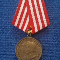 Medalie Eliberarea de sub jugul fascist - In slujba poporului muncitor