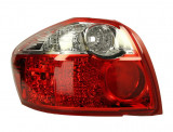 Cumpara ieftin Stop tripla lampa spate stanga (semnalizator alb, culoare sticla: rosu) TOYOTA AURIS 2010-2012