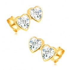 Cercei din aur galben de 14K - două inimi simetrice decorate cu zirconii