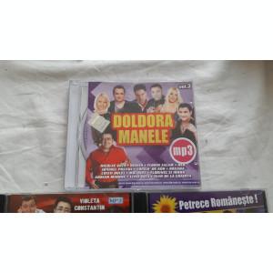 CD MANELE  MP 3-URI  . SUNT 3 BUCATI . CD-URI FARA ZGARIETURI .