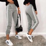 Pantaloni dama lungi de tip jogger din bumbac gri cu dungi albe laterale