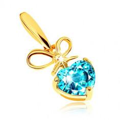 Cumpara ieftin Pandantiv din aur 375 - fundiță și inimă din topaz în nuanță albastră
