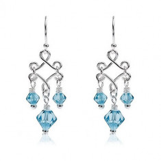 Cercei detașați din argint cu perle de sticlă albastre