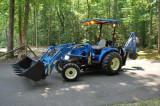 Tractor New Holland TC-33DA 4x4 + W/Loader + Buldoexcavatoare