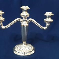 Sfesnic argintat cu trei brațe