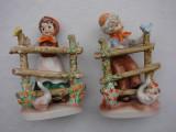 Cumpara ieftin Doua figurine mari din portelan german - baietel si fetita cu gasca