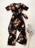 Salopeta dama casual lunga neagra cu imprimeu floral corai si cordon in talie