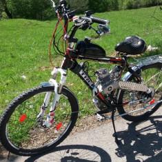 Bicicleta cu motor.