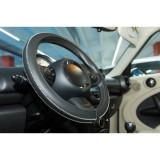 Husa volan Artisan , Handmade, din piele sintetica, diametru 37-39 cm , Neagra cu cusatura alba Kft Auto