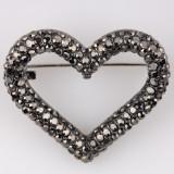 Cumpara ieftin Brosa metalica inima acoperita cu pietre aurii