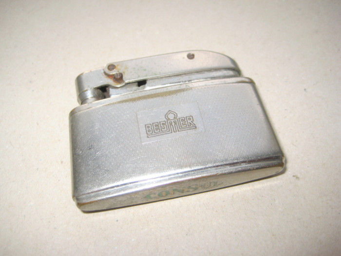 B966-I-Bricheta CONSUL BESMER veche alama argintata nefunctionala.