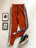Cumpara ieftin Pantaloni dama casual portocalii tip jogger cu dungi laterale negre si imprimeu YES