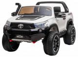 Cumpara ieftin Masinuta electrica SUV Premier Toyota Hilux, 12V, 4x4, roti cauciuc EVA, scaun piele ecologica, alb