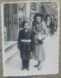 Stradala Centrul Vechi al Ploiestiului, elev militar, reclame// fotografie, Portrete, Romania 1900 - 1950