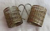 Doua suporturi de pahare din metal alamit filigramate