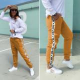 Pantaloni dama casual portocalii tip jogger cu dunga alba
