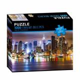 Cumpara ieftin Puzzle modern cu zgarie-nori in noaptea luminata din New York, 1000 piese, model Premium