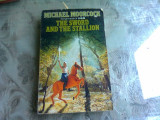 THE SWORD AND THE STALLION - MICHAEL MOORCOCK (CARTE INB LIMBA ENGLEZA)