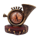 Trompeta cu ceas, asezate pe suport in forma de geamantan, Bronz, 616E