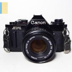 Canon AV-1 cu obiectiv Canon 50mm f/1.8 montura Canon FD