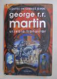URZEALA TRONURILOR , SERIA CANTEC DE GHEATA SI FOC , EDITIA A II -A de GEORGE R.R. MARTIN , 2011 *COTOR LIPIT CU SCOCI