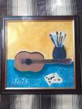 Natura statica cu o chitara