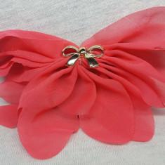 Elastic par tip floare, cu fundita din plastic, culoare roz inchis