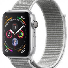Smartwatch Apple Watch 4, 44mm, LTPO OLED Retina Display, GPS, Bluetooth, Wi-Fi, Bratara Sport Loop Argintie, Carcasa aluminiu, Rezistent la apa si pr