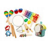 Cumpara ieftin Set muzical din lemn Ecotoys cu 10 instrumente Multicolor