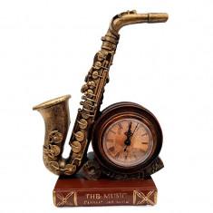 Saxofon cu ceas, asezate pe suport in forma de carte, 614E