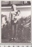 bnk foto - Copil cu papusa