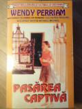 PASAREA CAPTIVA - WENDY PERRIAM