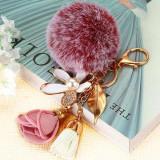 Breloc pufos din blana tip pompon, pandantiv floare cristal 5 petale cu frunza si perla, trandafir si canafi