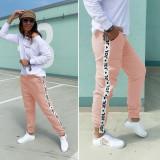 Cumpara ieftin Pantaloni dama casual roz tip jogger cu dunga alba