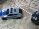 Masinuta de politie cu telecomanda 1:64